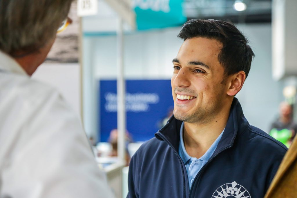 The CFO & Co-founder of SailSterling, Kiran Fothergill speaks with customer at the Düsseldorf Boat Show about luxury tours and luxury yacht charters