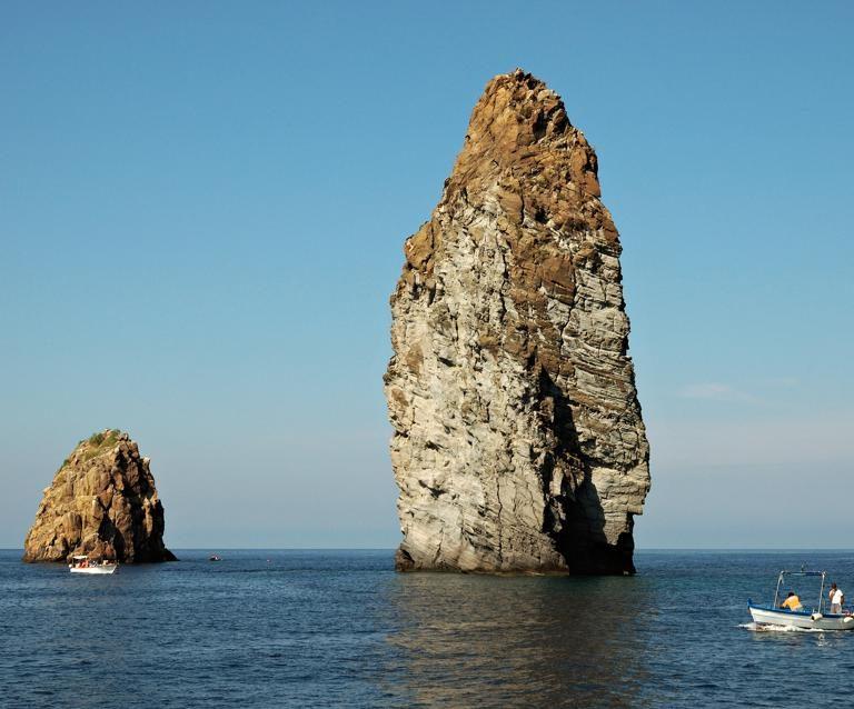 En route to Lipari the Wine and Catamaran Club Tour passes the amazing Faraglioni di Lipari.